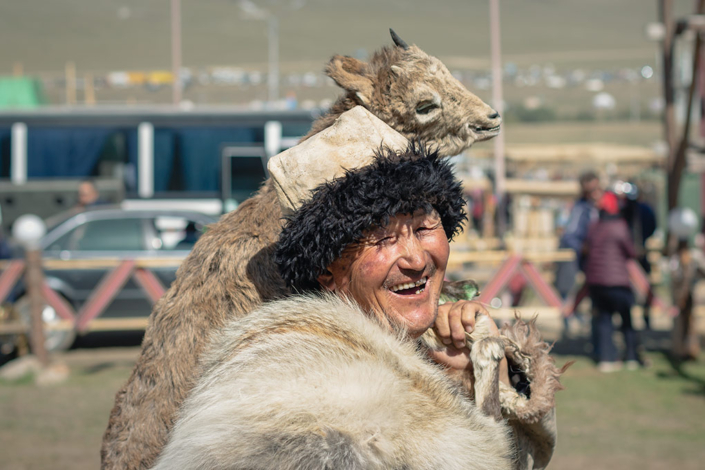 Dressed in traditional hunting gear, this guy was without doubt the happiest person at the World Nomad Games. Smiling from ear to ear, eyes squinting in delight, he's carrying a stuffed animal over his shoulder.