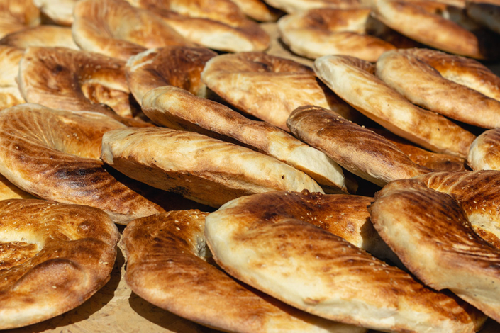 Bread, bread bread - freshly baked and delicious. Fresh bread hot from the oven, piled in layers. The perfect thing to keep you going at the World Nomad Games.