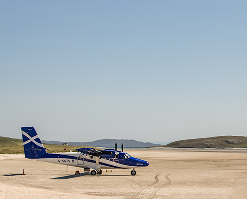 How To Find The Best Value Flights: A small plane lands on Barra Beach