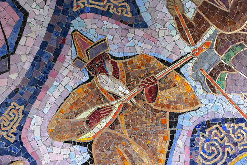 Perhaps the most elaborate example of Soviet-era art and architecture in Almaty. The spectacular Enlik-Kebek mosaic covers the wall to the right of the main entrance of the Hotel Almaty, dating from 1965. It tells a Kazakh folk tale of star crossed lovers in exquisite detail. This close-up shows a minstrel playing the lute.