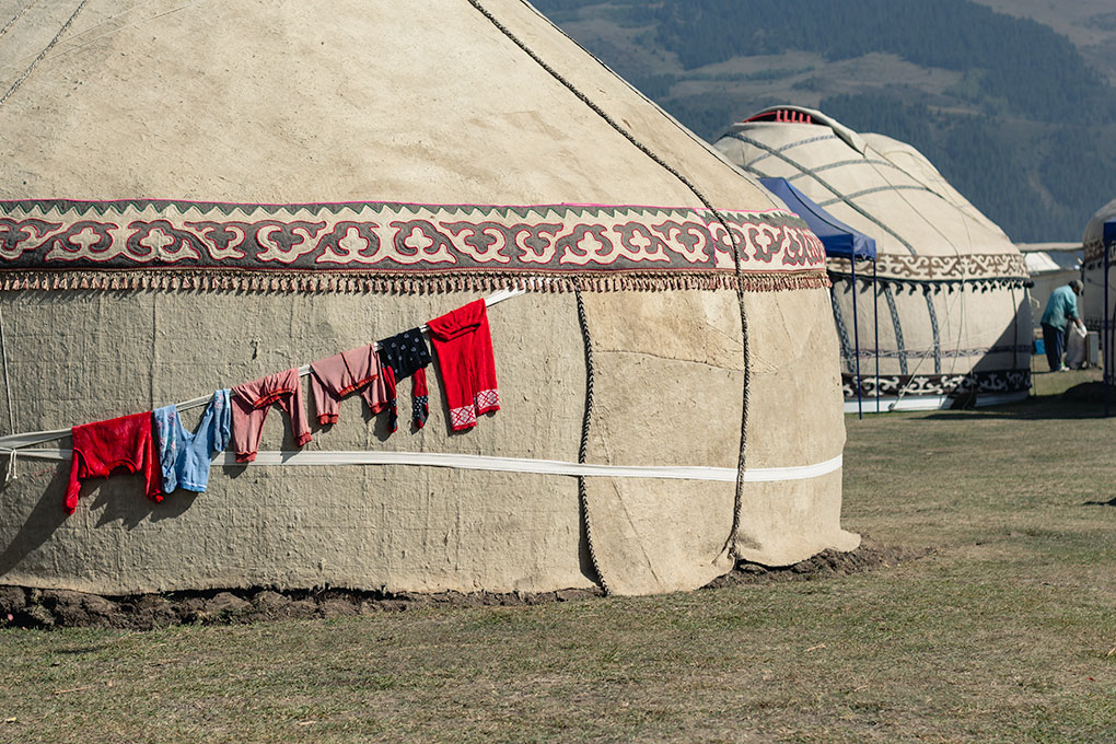 Colourful children's clothing, hung up to dry outside one of the traditional Kyrgyz yurts in Kyrchin Gorge at the World Nomad Games in Kyrgyzstan.
