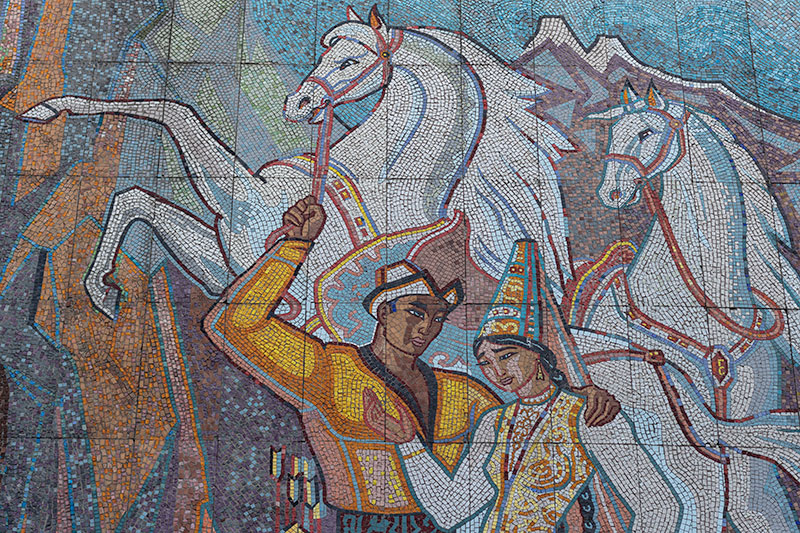 The huge mosaic dominating the northern facade of the Almaty Wedding Hall. It features a young couple in traditional dress, majestic white horses rearing up behind them by a gushing waterfall. To me, the woman's eyes look sad.