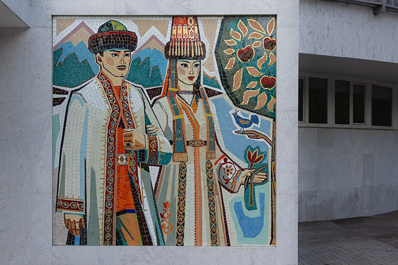 The modern mosaic of the happy couple at the entrance to the Almaty Wedding Palace